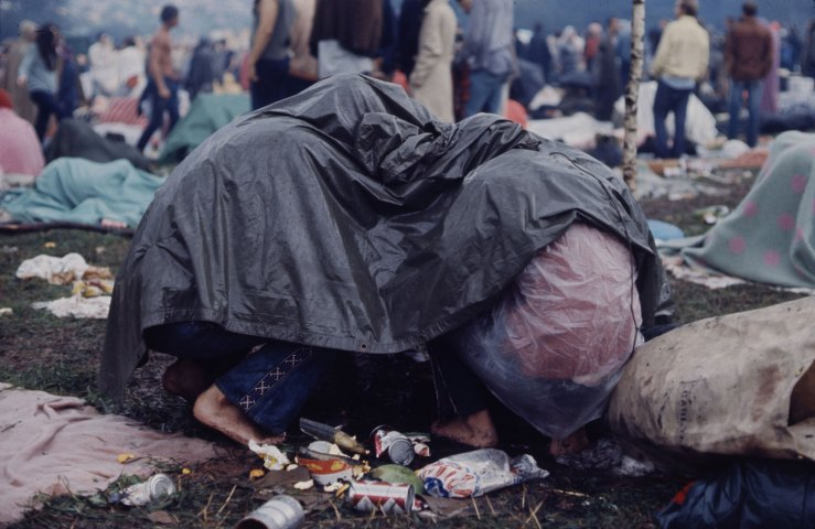 hippies under a tarp